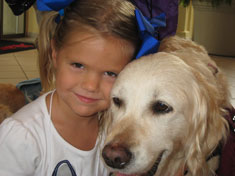 Girl Hugging Service Dog