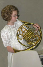 Girl Playing French Horn