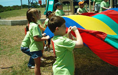 Kids playing with parachute