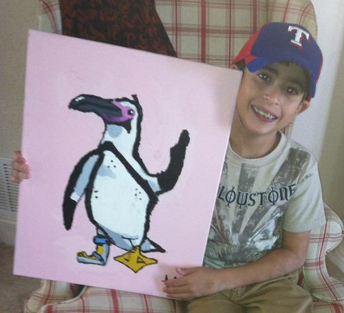 Boy with hemiplegic cerebral palsy paints during occupational therapy