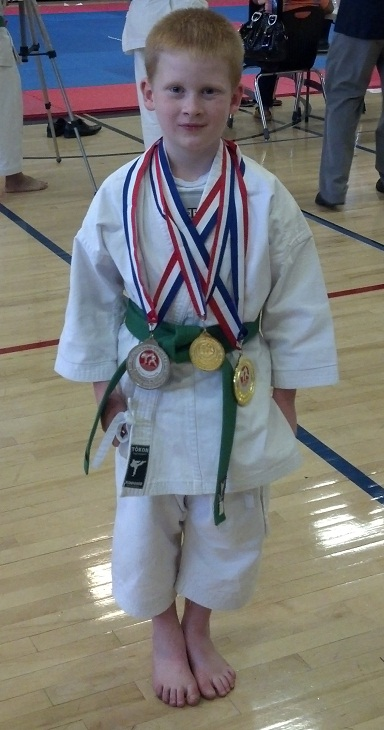 Boy with hemiplegia wins karate contest
